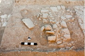 Fig. 7: View of partially excavated grave cut, which postdates the line of W4003 (Jackson 2009–2010)