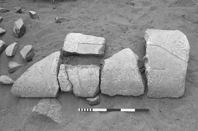 Fig. 5: Fragments of an inscribed marble sarcophagus lid (T2031), found in a garden wall belonging to Şerafettin Arıözsoy (Lightfoot 2006–2007)