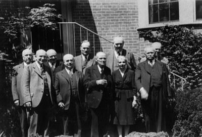 Back row: Edward K. Rand, George La Piana, John C. Baker, Robert Blake, Charles Rufus Morey. Front row: Albert M. Friend, Paul Sachs, Michael I. Rostovtzeff, Sirarpie Der Nersessian, and Alexander A. Vasiliev. AR.PH.Misc.273.