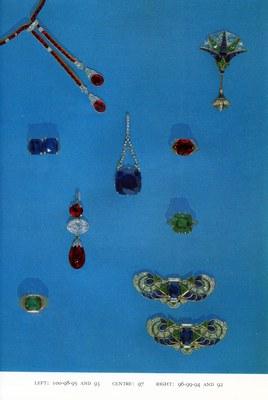 Jewelry, Including 24.9 carat sapphire and diamond pendant (97, center), 9 carat emerald and diamond ring (94, right, lower middle), and diamond and sapphire broochs (92, lower right).
