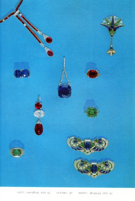 Jewelry, Including 24.9 carat sapphire and diamond pendant (97, center), 9 carat emerald and diamond ring (94, right, lower middle), and diamond and sapphire brooches (92, lower right).