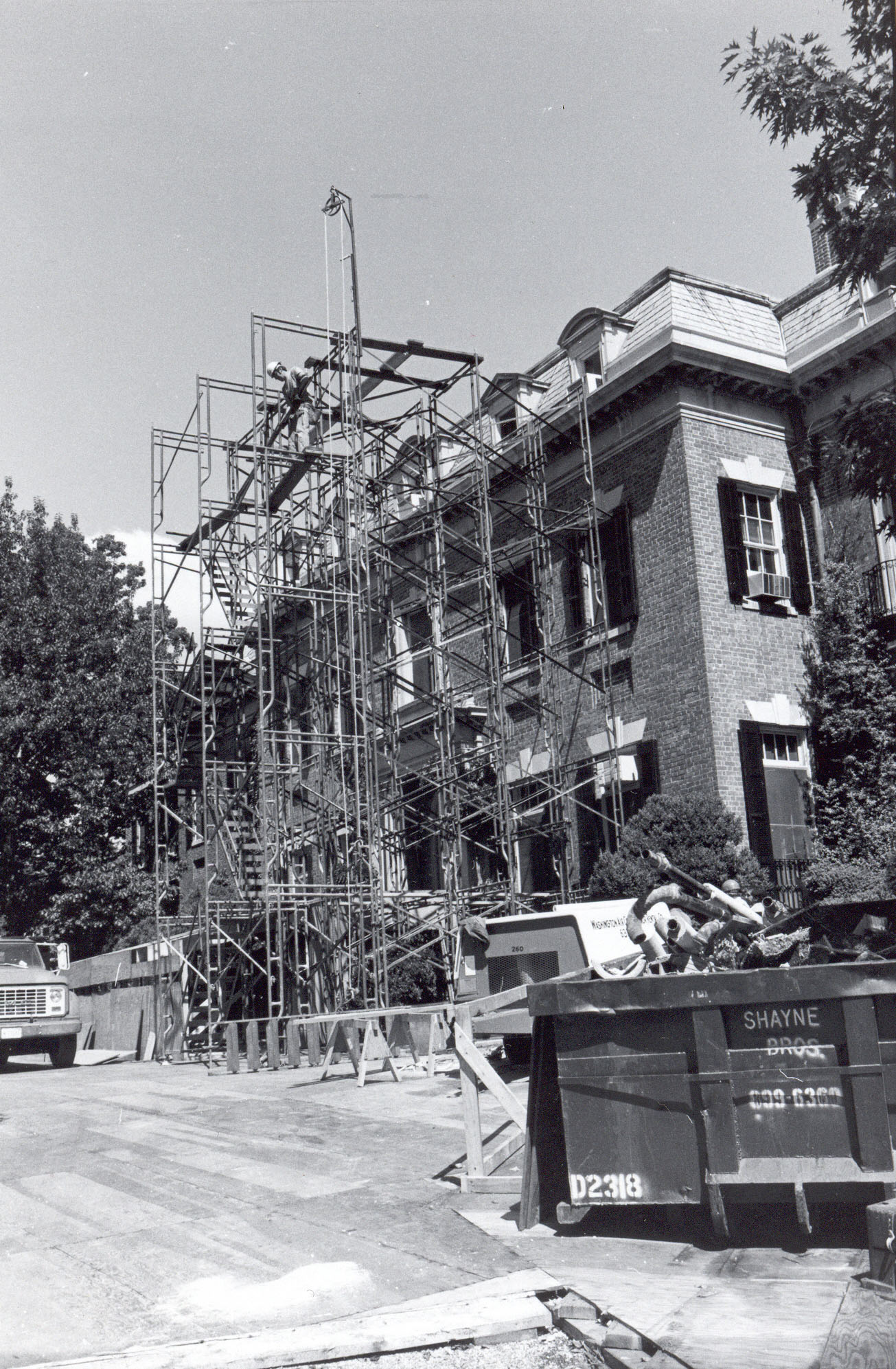 Scaffolding for roof repair and third-floor renovation, ca. 1978