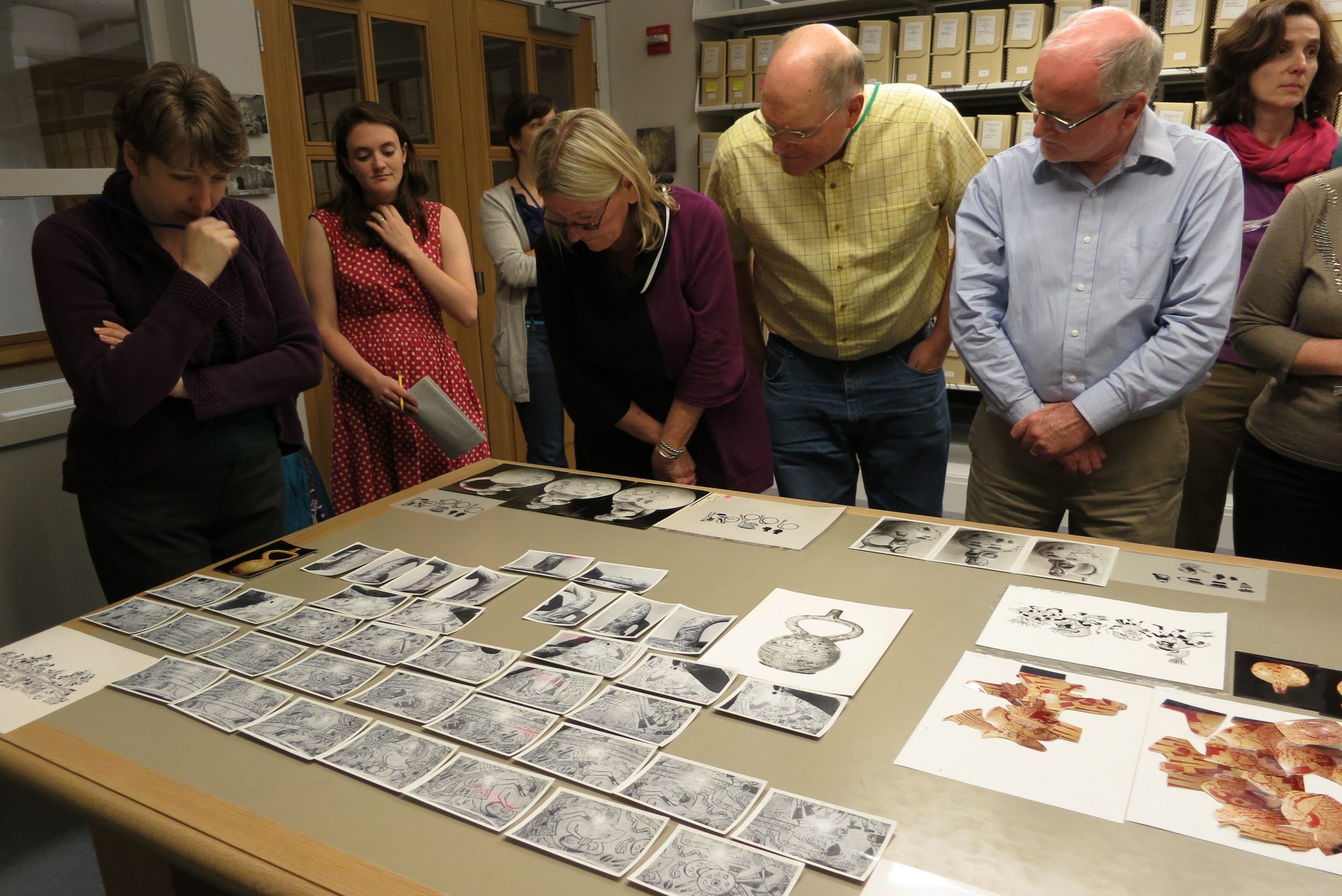 Dumbarton Oaks staff and Fellows examining the Donnan and McClelland Moche Archive in the Image Collections and Fieldwork Archives