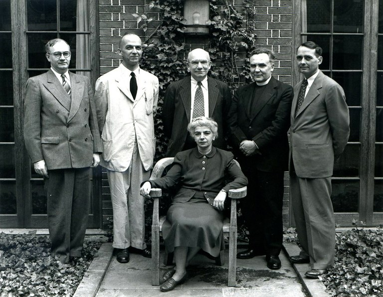 """Speakers at the 1948 Byzantine Studies Symposium, """"Byzantium: The Church of the Holy Apostles in Constantinople."""" Sirarpie Der Nersessian, seated, and, left to right, Milton Anastos, Glanville Downey, Albert M. Friend, Francis Dvornik, and Paul Underwood"""