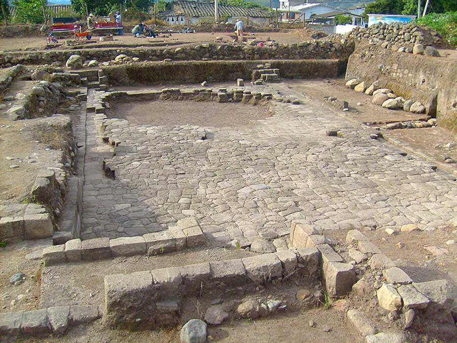 Fig. 1: Semi-subterranean temple comprising central feature of religious-ceremonial precinct of Inca-Caranqui at eastern end of municipal lot looking to north. Note the two separate flooring episodes in evidence, the baffled, step-down entryways in NE and NW corners of temple (mirroring the SE and SW corners), and the covered exit canal located at center-east side of floor (right side of photo). The large void at the north end of floor was found as is in the 2006 excavations and may represent a Colonial period removal event.