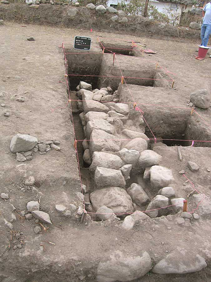 Fig. 4: The eastern, north-south trending Inca wall (Fea 1) on north side of semi-subterranean temple exposed during test excavations in 2008 corresponding to one of anomalies identified through remote-sensing, looking north. Wall is 1.2m thick with roughly finished stones comprising exterior faces on either side and interior rubble fill.