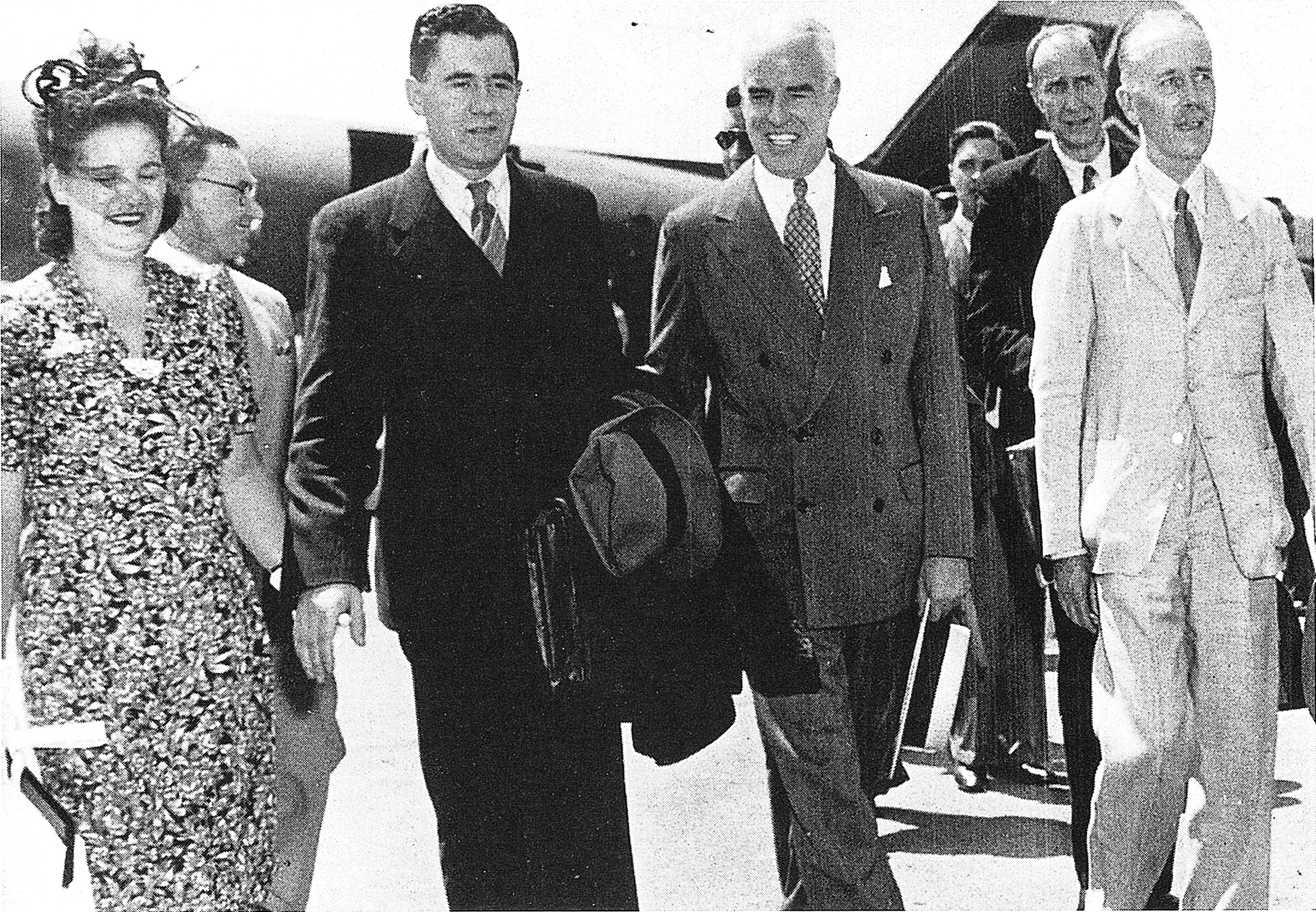 Andrei A. Gromyko, Soviet ambassador to the United States, and his wife are welcomed upon their arrival in Washington by the chairmen of the American and British delegations