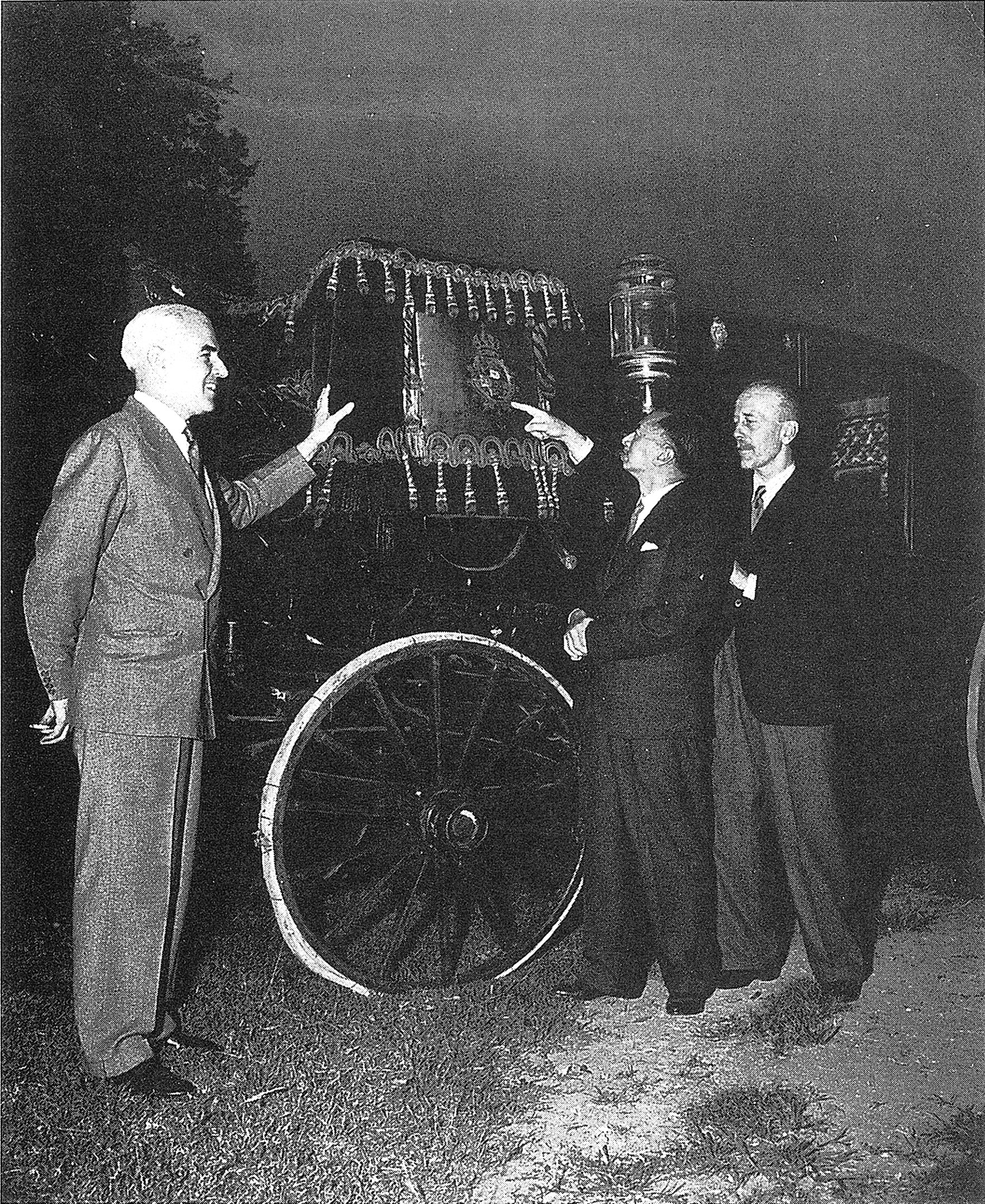 Edward R. Stettinius, Jr., explaining the coat of arms on the coach used by Kaiser Wilhelm of Germany at his coronation
