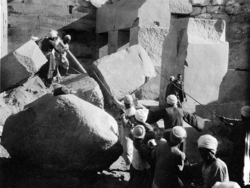 Local workmen moving a stone block
