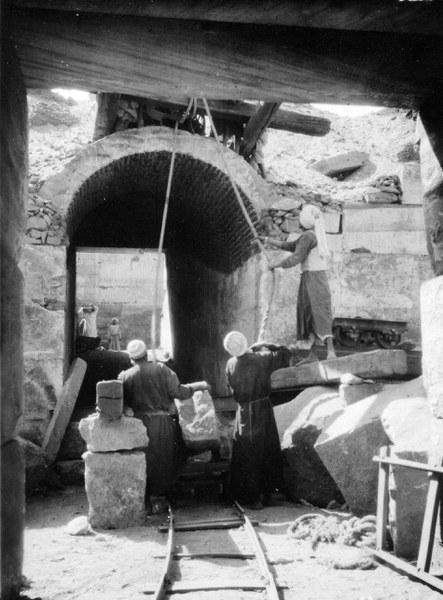 Local workmen pulling a stone block
