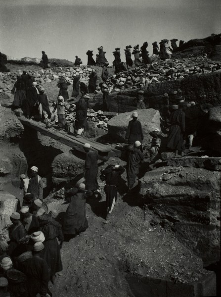 Local workmen in an assembly line