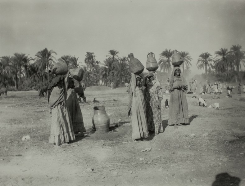 Women carrying ceramic jugs over their heads