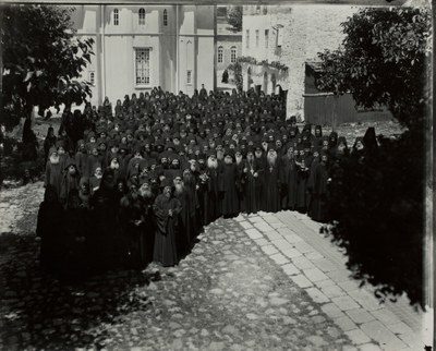 Group of monks in the courtyard behind the church