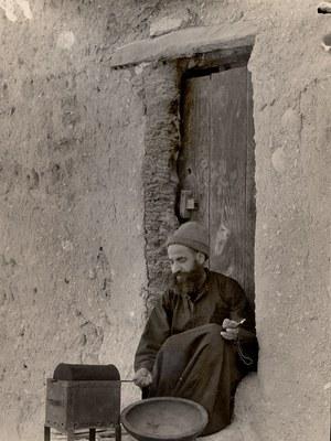 Monk roasting coffee