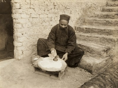 Monk stamping the Holy Bread
