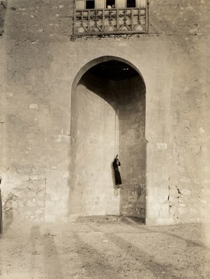 Old entrance; monk hoisted by rope lift into upper level entrance