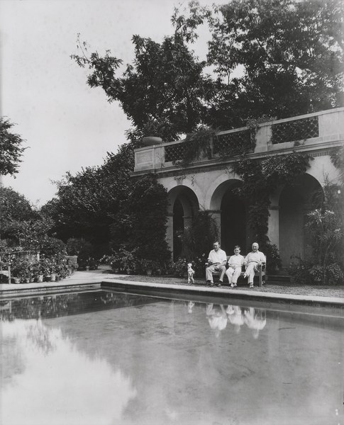 Men and dog sitting by the Swimming Pool, 1930–1935