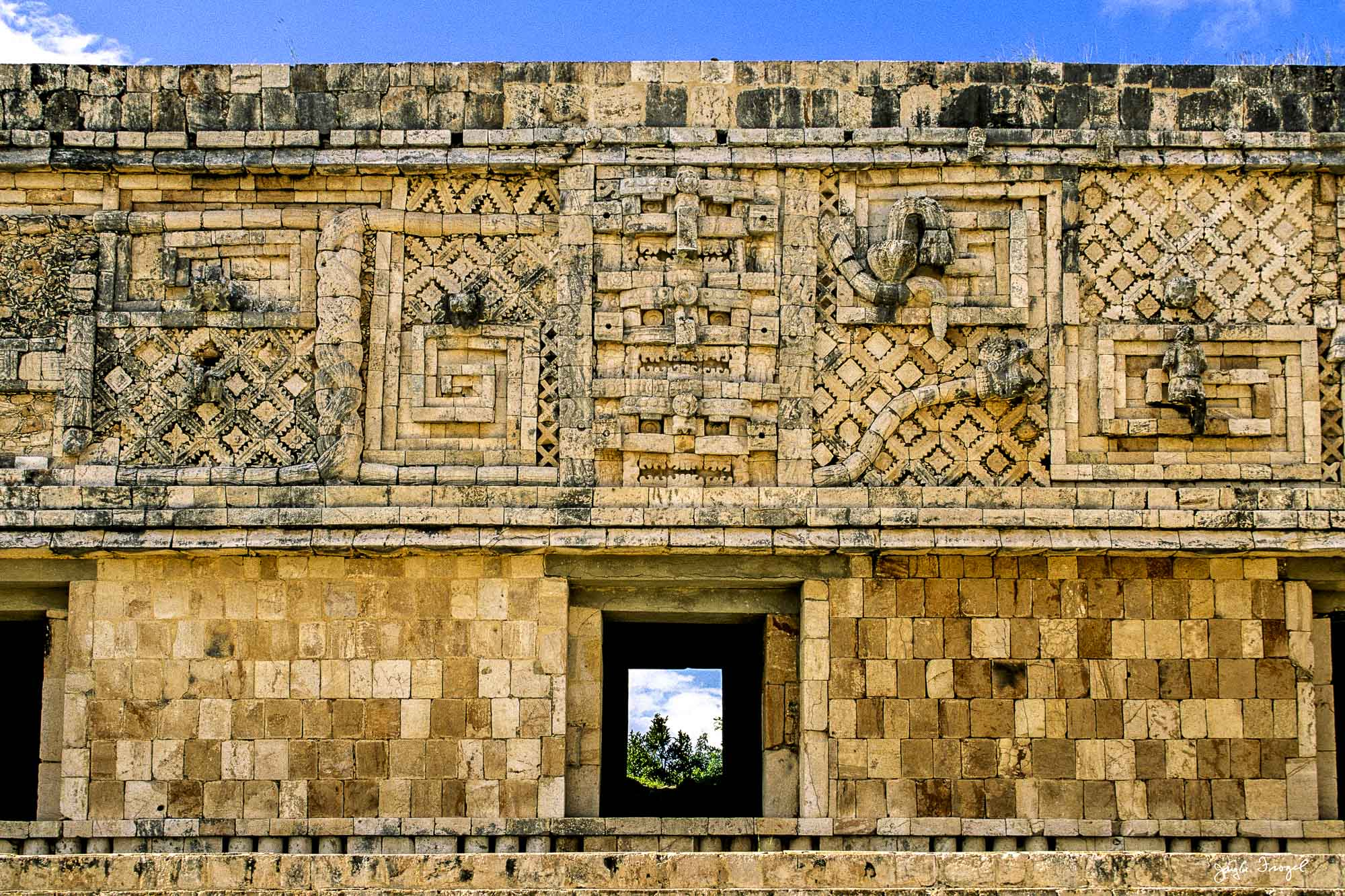 Uxmal, Entwined Serpents on Façade at the North End of the West Building, Nunnery Quadrangle. Photo: Jay A. Frogel.